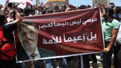 فتح تستهجن قيام حماس بتنظيم مسيرة مؤيدة لمحمد مرسي في باحات الأقصى