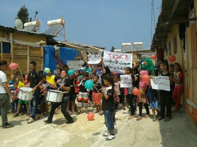 مسيرة تضامن لأطفال مخيم نهر البارد مع غزة