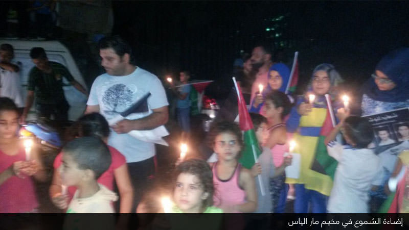 مخيم مار الياس يضيء الشموع على أرواح شهداء الانتفاضة الثالثة