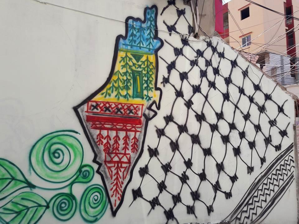 رسم جدارية النادي الثقافي الفلسطيني العربي في مخيم البداوي